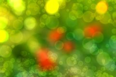 Blurred abstract background bokeh. Blurry abstract background with bokeh effect, poppies in the grass Stock Photography