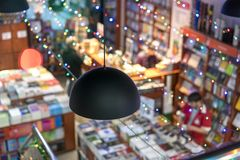 Blurred abstract background of book on bookstore. blurry bookshelf in library room for your background.  Royalty Free Stock Image