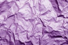 Blurred abstract background of crumpled purple paper surface. royalty free stock photo