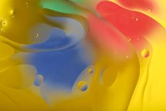 Blurred abstract background. Image of red, blue, green and yellow circles and wavy lines of different sizes. stock photo