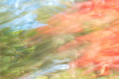 Blurred abstract background. Orange blue and green. Stock Photo