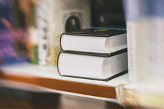 Blurred abstract background of Two thick volumes Fiction in book store, in library. Concept of education, school, study. Blurred abstract background of Two thick Royalty Free Stock Images