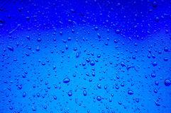 Blurred abstract background view of Rain drops on window surface Stock Photos