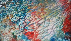 Blurred blue red brown gray orange silvery pastel creative paint hues. Abstract paint watercolor background Royalty Free Stock Images