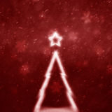 Blurred abstract Christmas tree on red Christmas background Stock Image