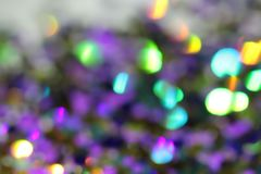 Blurred abstract creative background. Purple, pink and lilac bac. Kground. Lens flare. Colorful bokeh light. Illuminated burst of multicolor light. Lights of the vector illustration