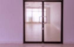 Blurred abstract glass door of empty room Stock Photos