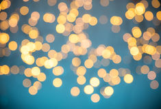 Blurred abstract golden spot lights. Blurred Christmas abstract golden spot lights with soft blue background stock photos
