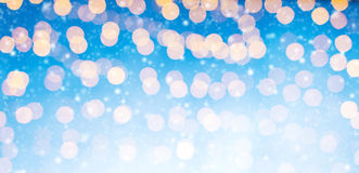 Blurred abstract golden spot lights. Blurred Christmas abstract golden spot lights with soft blue background royalty free stock image