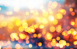 Blurred abstract golden spot lights on dark background. Blurred Christmas abstract golden spot lights on dark background royalty free stock photos