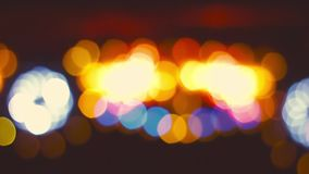 Blurred abstract moving lights in amusement park; Bokeh effect stock video footage