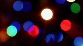 Blurred abstract moving lights Bokeh effect. Christmas tree. 4K background