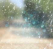 Blurred abstract photo of light burst among rtees and glitter bokeh lights. filtered image and textured.  royalty free stock photography
