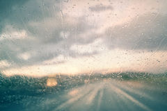 Blurred abstract vehicle driving in the heavy rainy day Royalty Free Stock Image