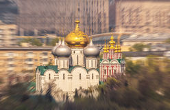 Blurred abstract view of orthodox church with golden cupola inside the Moscow city under spring sun light Royalty Free Stock Photos