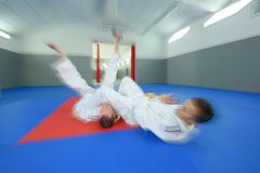 Blurred action shot judo combat. Blurred action shot of judo combat stock photography