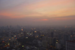Blurred aerial view of cityscape on warm light sundown, Bangkok stock images