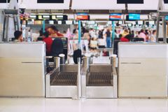 Blurred airport check in desk counter gate with weighting luggage belt.  stock images