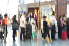 Blurred airport, traveler silhouettes in motion blur Stock Photos