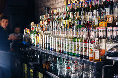 Blurred alcohol bottles on a bar Royalty Free Stock Photos
