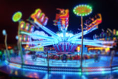 Blurred Amusement park ride at night. conceptual image of entert Royalty Free Stock Images