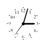 Blurred analogue clock face dial silhouette. Abstract black and white analogue clock face dial reading 3:03 PM, isolated blurred macro silhouette stock photo