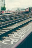 Blurred arrived red trains und rails in front of city station. Hamburg Royalty Free Stock Photos
