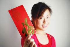 Blurred Asian girl show red Envelopes in her hands Royalty Free Stock Image