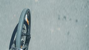 Blurred asphalt road and spinning bicycle front wheel and fork stock video footage
