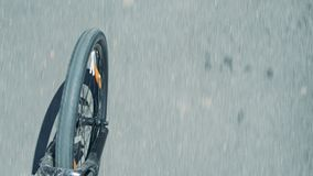 Blurred asphalt road and spinning bicycle front wheel and fork stock video
