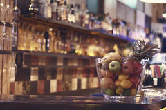 Blurred back bar. Bottles of spirits and liquor at the bar. Blurred desk in bar. Stock Photos