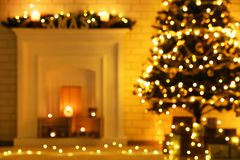 Blurred backgroud. Of decorated fireplace near christmas tree royalty free stock photography