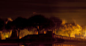 Blurred background (ancient temple and trees reflecting into the Royalty Free Stock Images