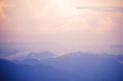 Blurred background of blue mountain and pink sky Royalty Free Stock Images