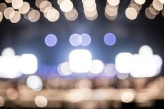 Blurred background : Bokeh lighting in concert with audience ,Mu Royalty Free Stock Image