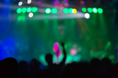 Blurred background : Bokeh lighting in outdoor concert with cheering audience Stock Image