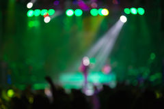 Blurred background : Bokeh lighting in outdoor concert with cheering audience Stock Photos