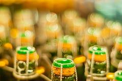 Blurred background - bottles of sparkling wine royalty free stock images