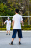 Blurred background : boy and girl playing badminton Stock Images