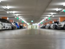 Blurred background of a car parking in the departmentstore. Car royalty free stock photos