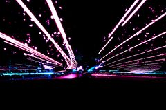 Blurred background with Cars light trails on a curved highway at night. Night traffic trails. Motion blur. Night road with traffic. Headlight motion. Cityscape royalty free stock photos