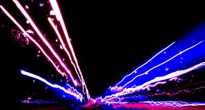 Blurred background with Cars light trails on a curved highway at night. Night traffic trails. Motion blur. Night city road with tr. Affic headlight motion royalty free stock images