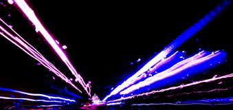 Blurred background with Cars light trails on a curved highway at night. Night traffic trails. Motion blur. Night city road with tr. Affic headlight motion stock photography
