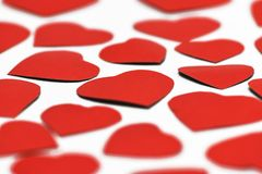 Blurred background, close cut a lot of red hearts on a white background. royalty free stock images