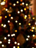 Blurry background of lights on the Christmas tree royalty free stock image