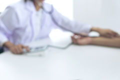 Blurred background of Competent attentive doctor being measuring Royalty Free Stock Images