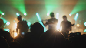 Blurred background of crowd partying at a concert. Stock Image