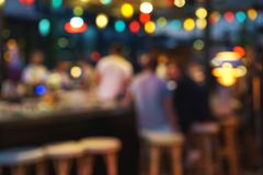 Blurred background of customer sitting at restaurant, bar or night club, with bokeh. royalty free stock photos
