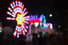 Blurred Background of Decorating Colorful Light Bulbs of Ferris wheel in amusement theme festival. Fun Park, Amusement Park, royalty free stock images