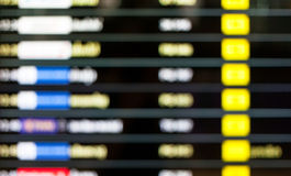 Blurred background of display schedule board in an airport with Royalty Free Stock Image